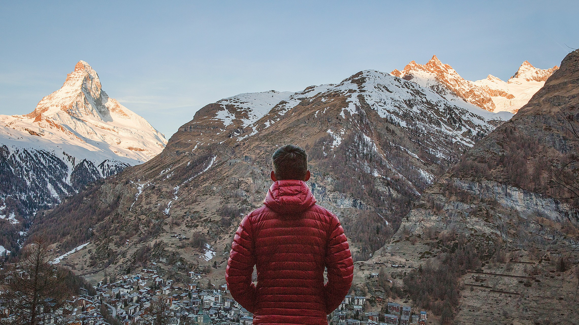 Man In Red Jacket Looking At The Alps In Zermatt Switzerland